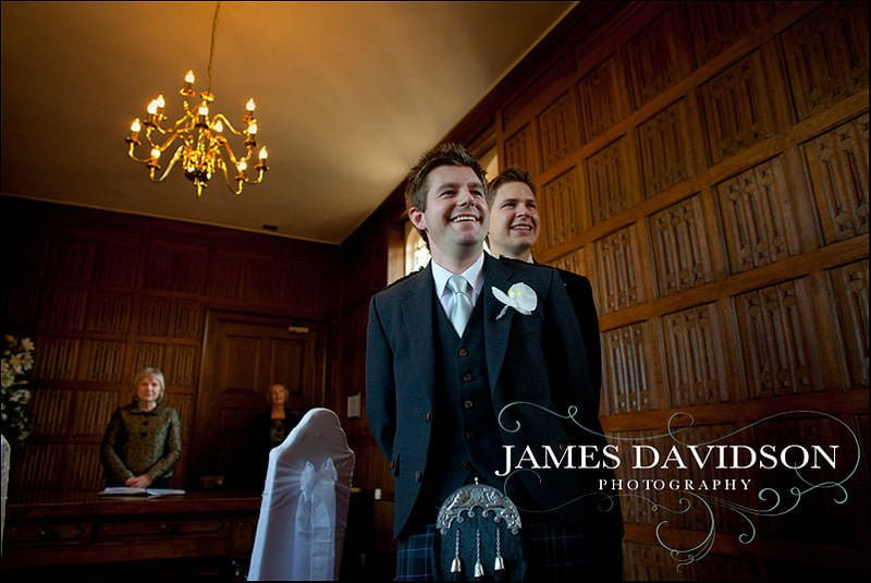 groom waiting for bride at the alter