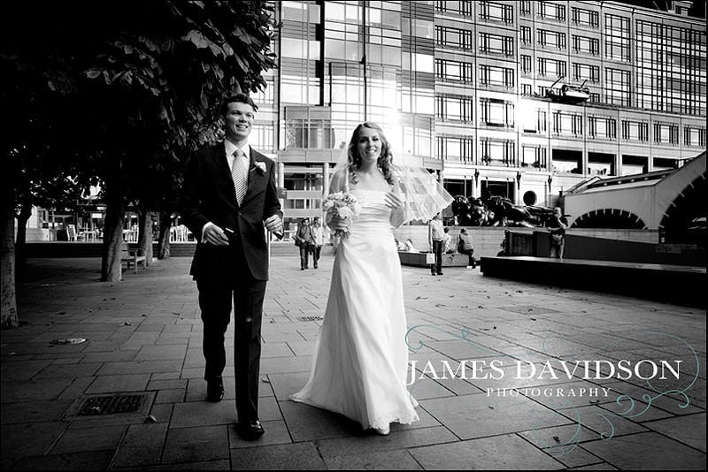 bride and groom walking through liverpool street station