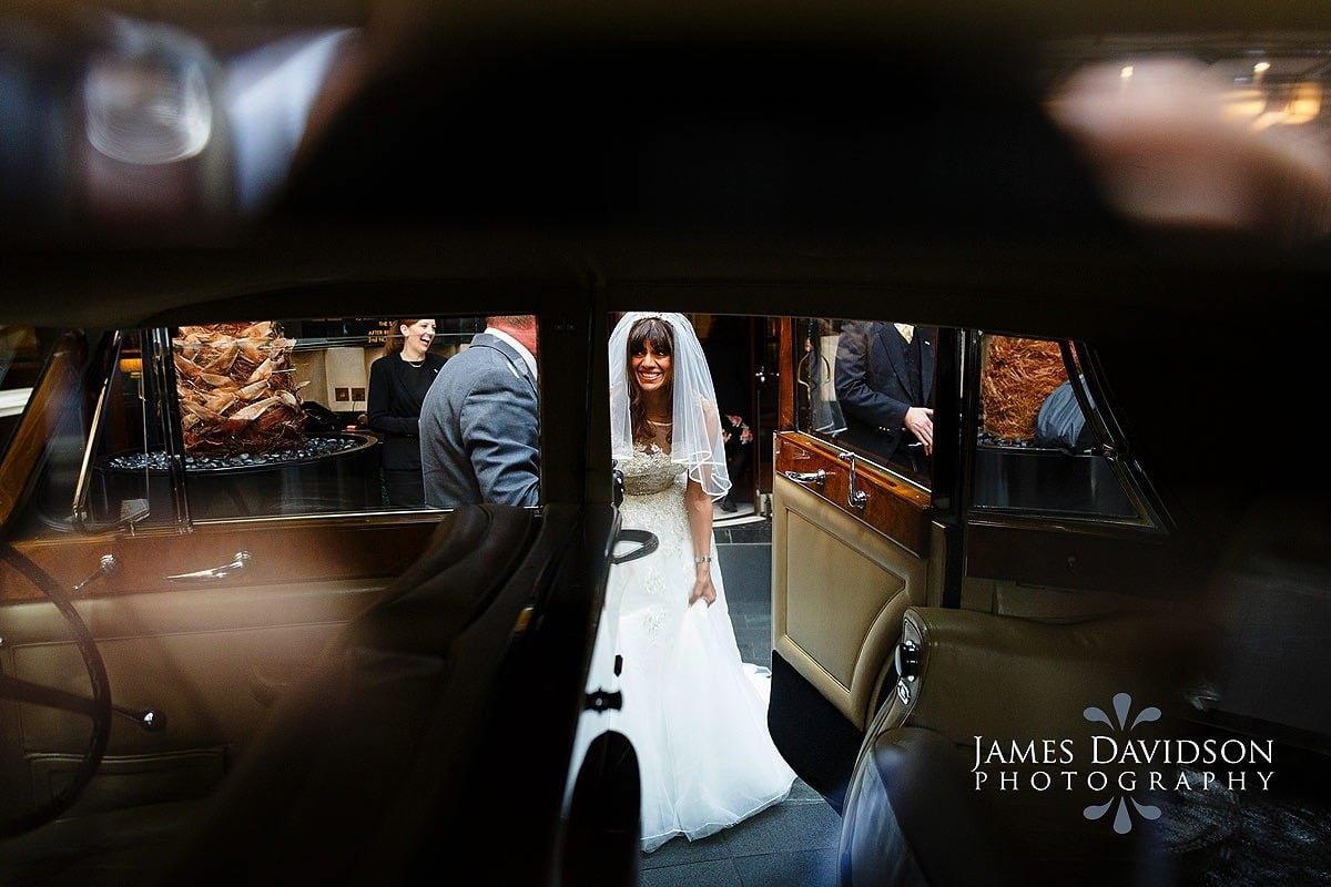 bride in car at Savoy wedding