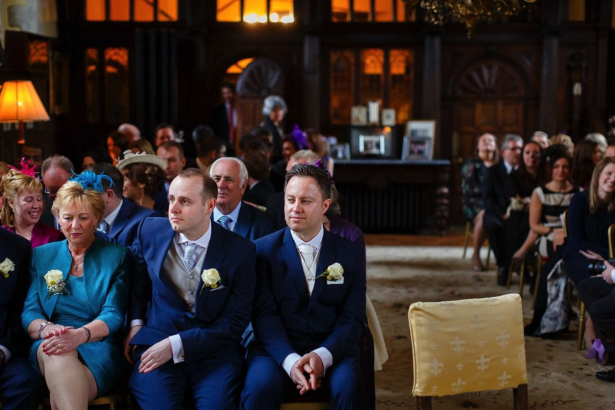 groom waiting in main hall at loseley park