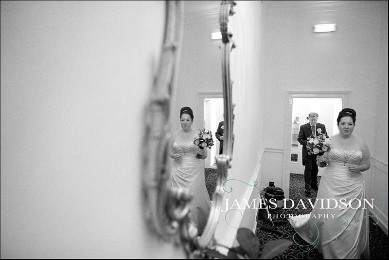 bride walking through Taplow house for her wedding