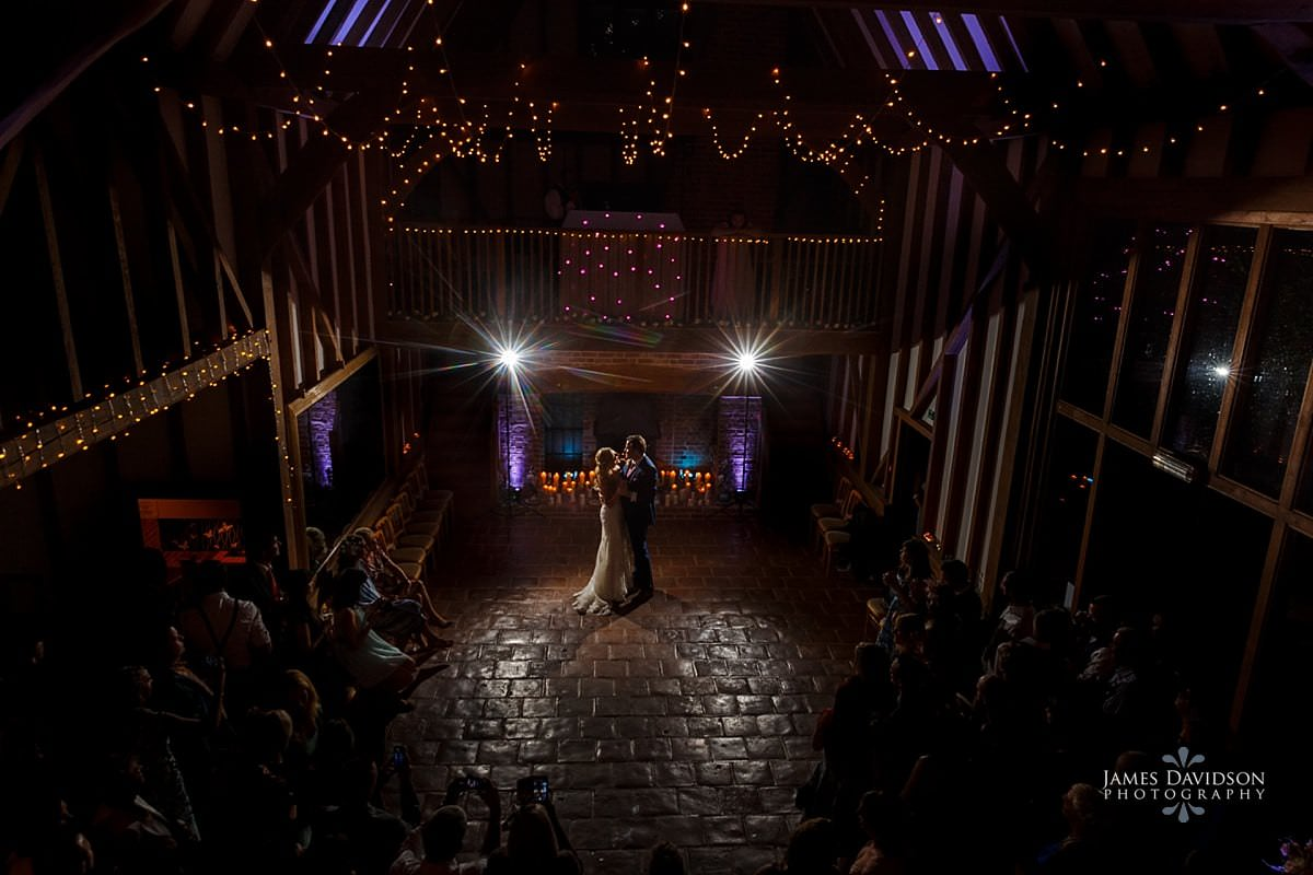 Barrandov Opera wedding photography first dance under fairy lights in the main barn
