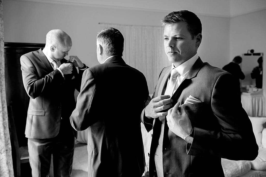 groom getting ready at Butley Priory wedding