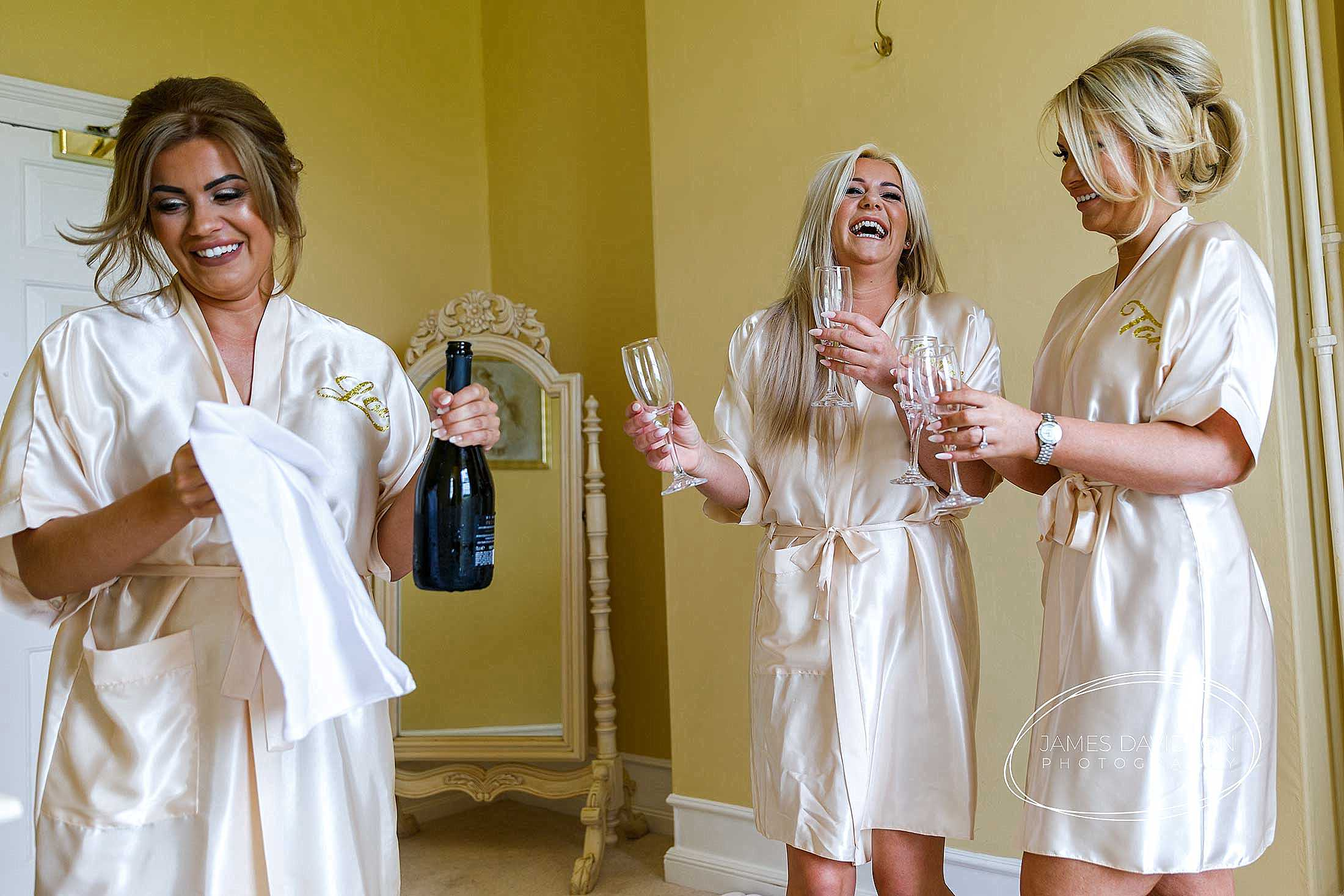 bridesmaids sharing champagne at Gosfield Hall